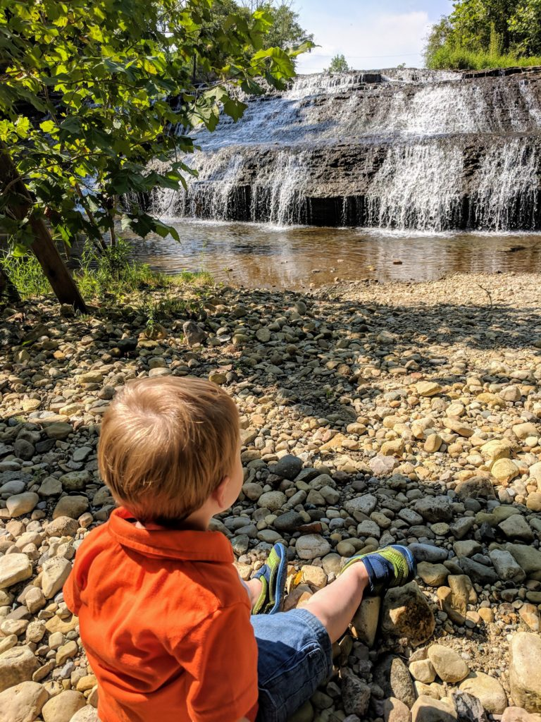 kid looking at waterfalls