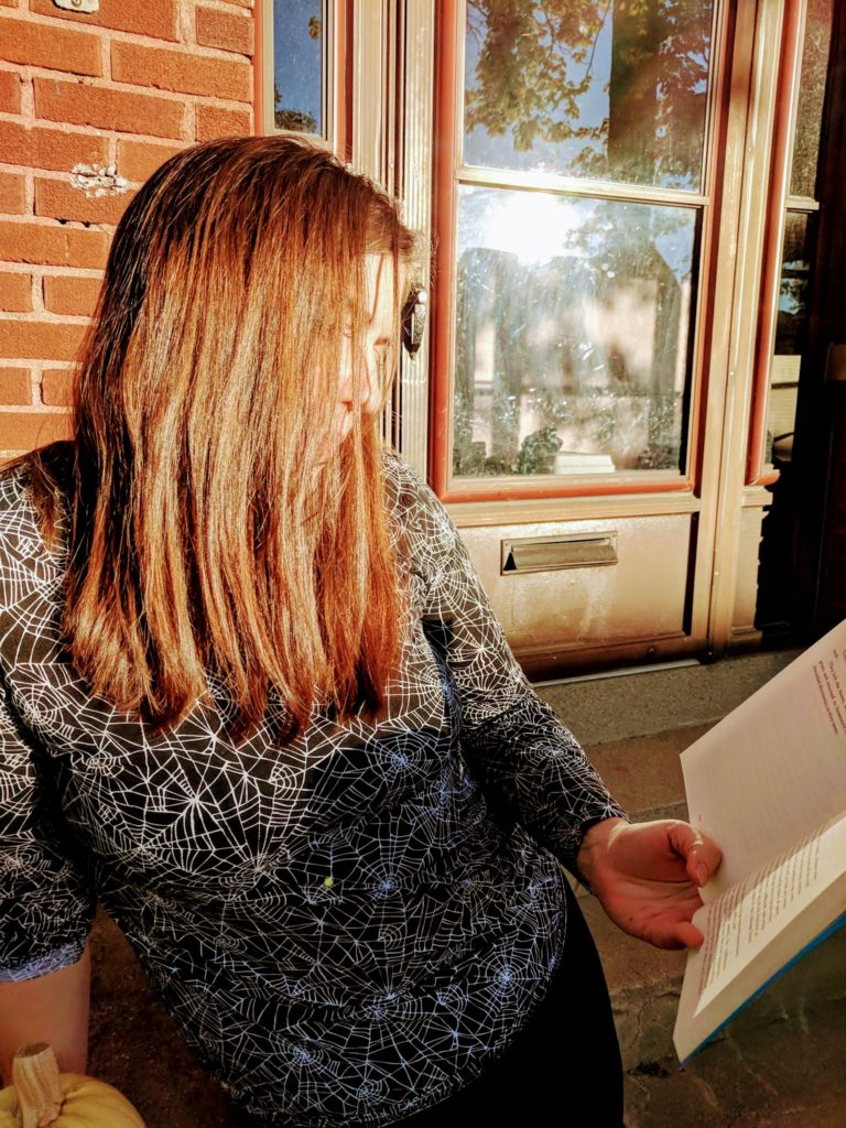 woman leaning with book