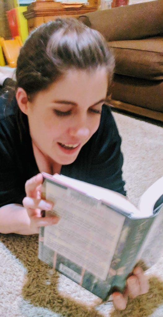 woman reading Joyce Carol Oates
