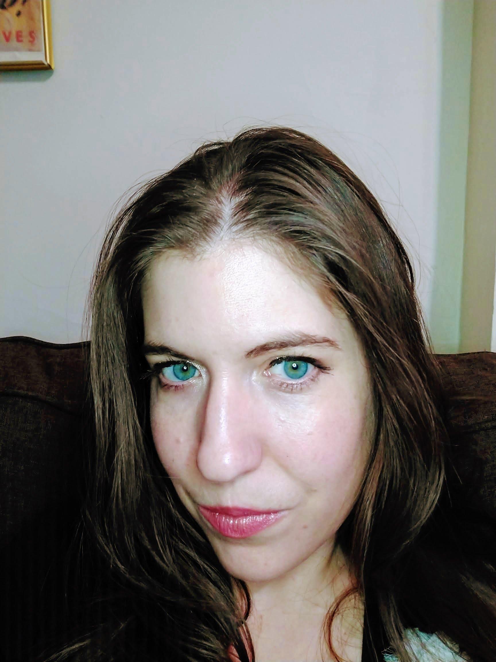 woman smirking into camera