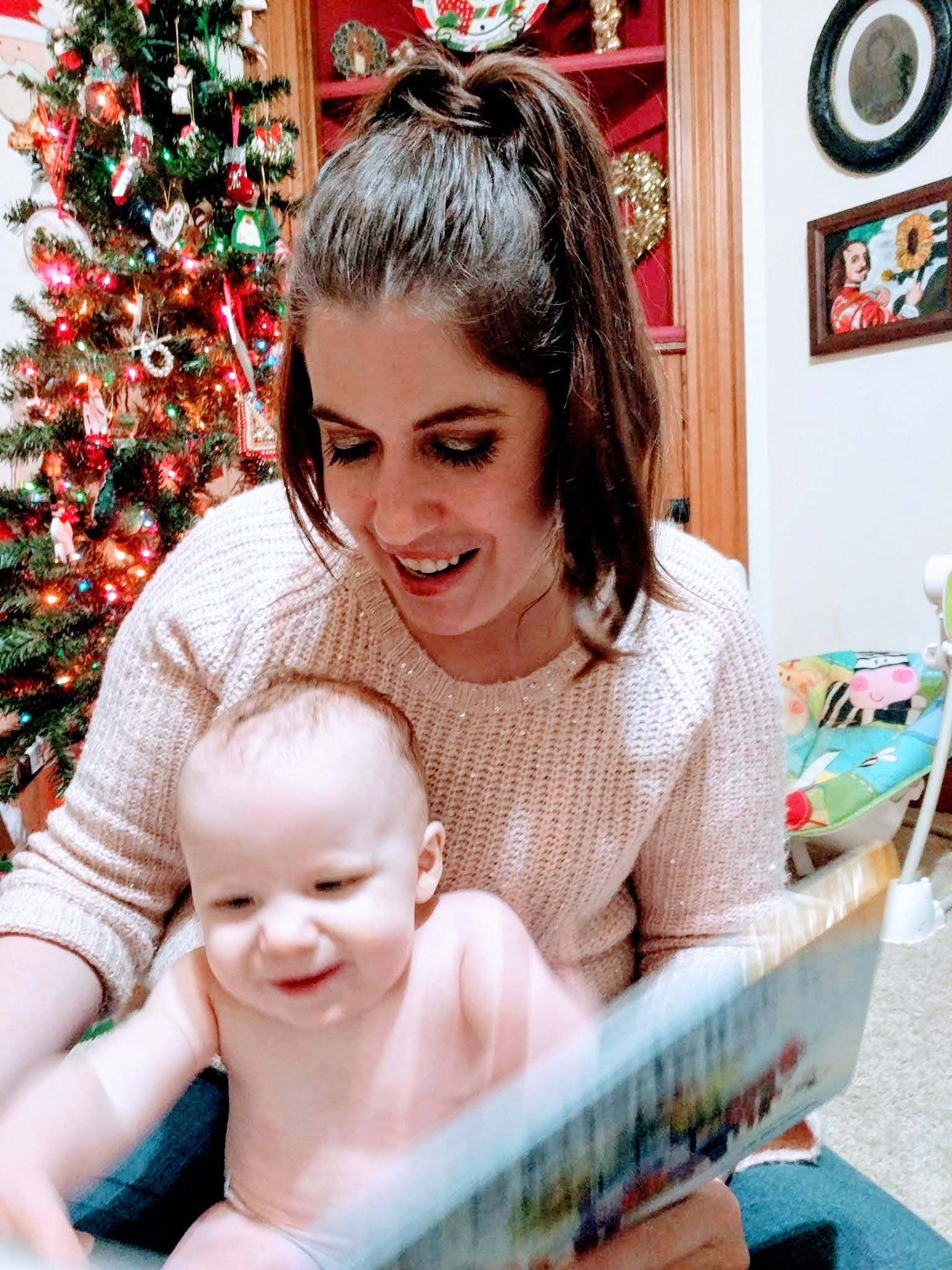 woman and baby reading book