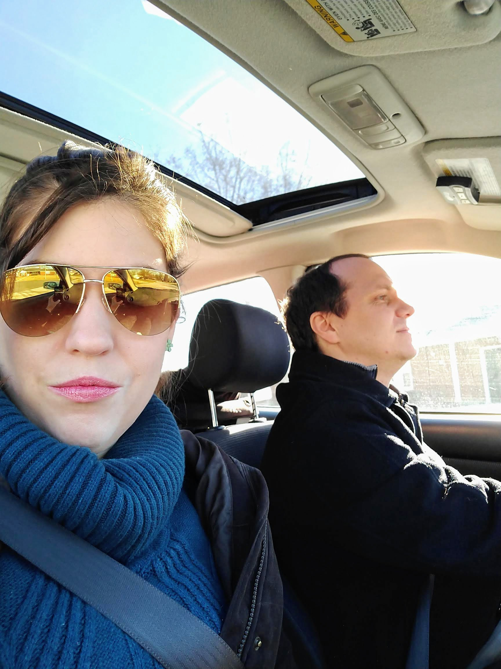 woman looking into camera in car with man