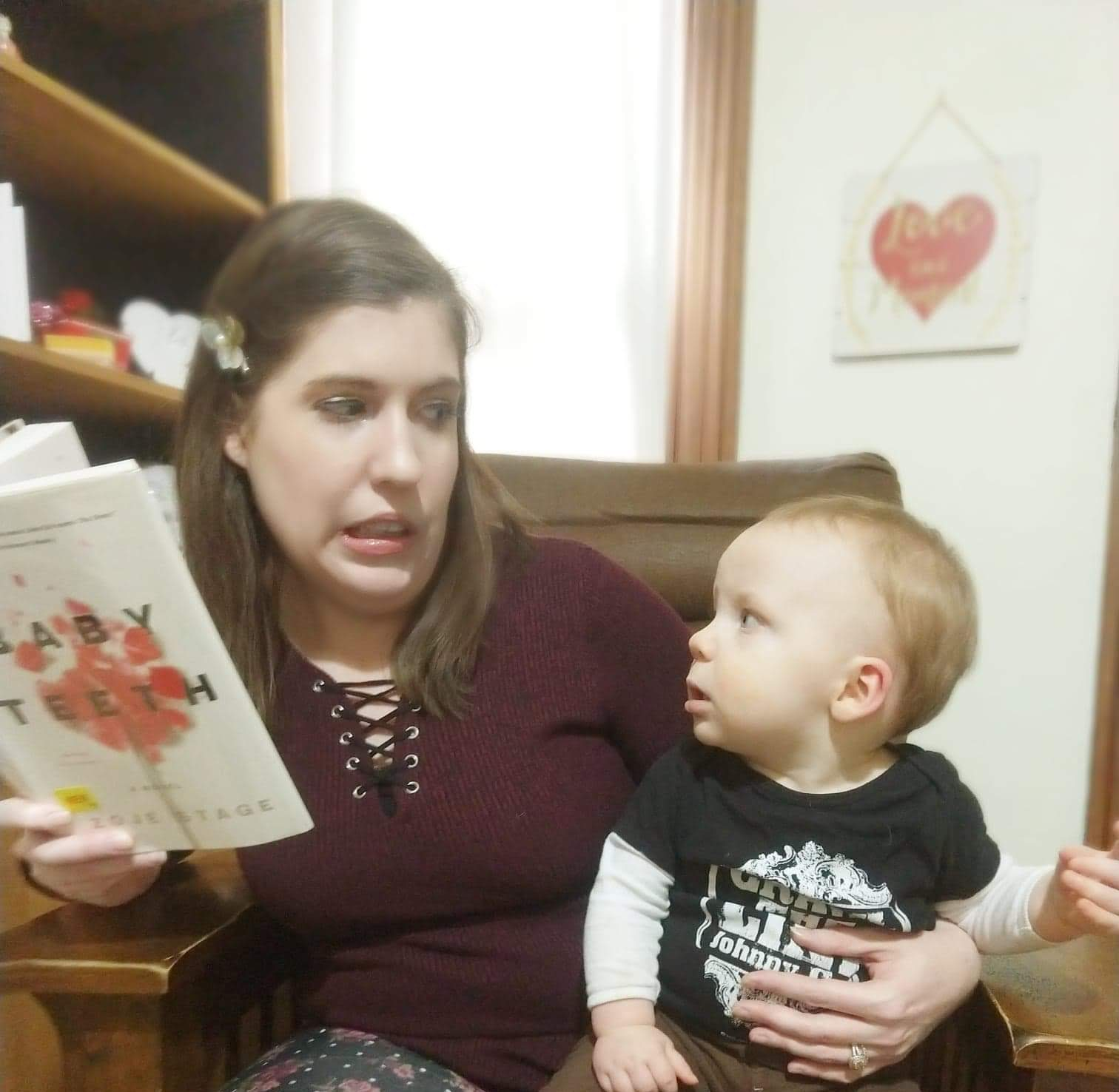 woman and baby looking suspiciously at each other