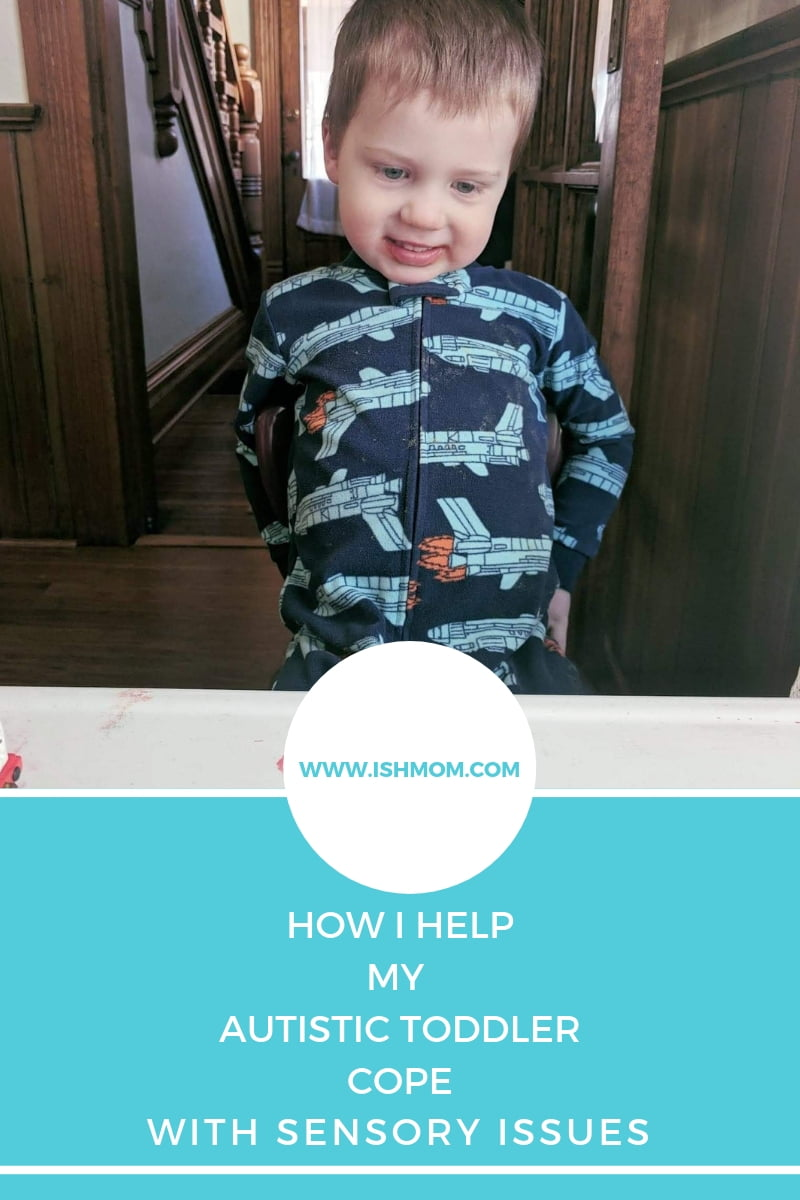 toddler wearing pyjamas looking at camera