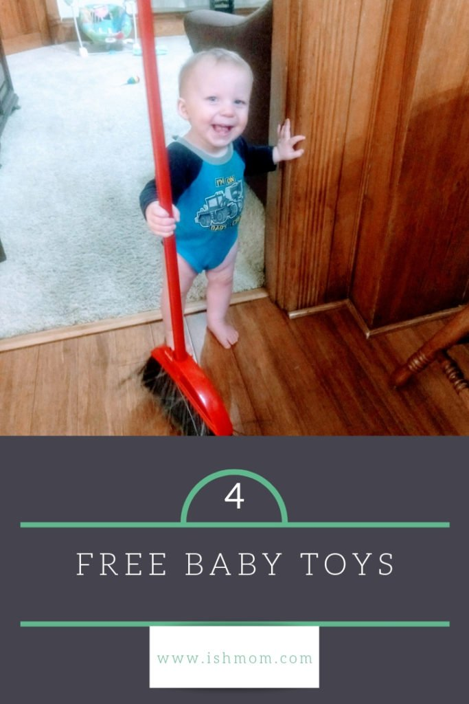 baby with broom