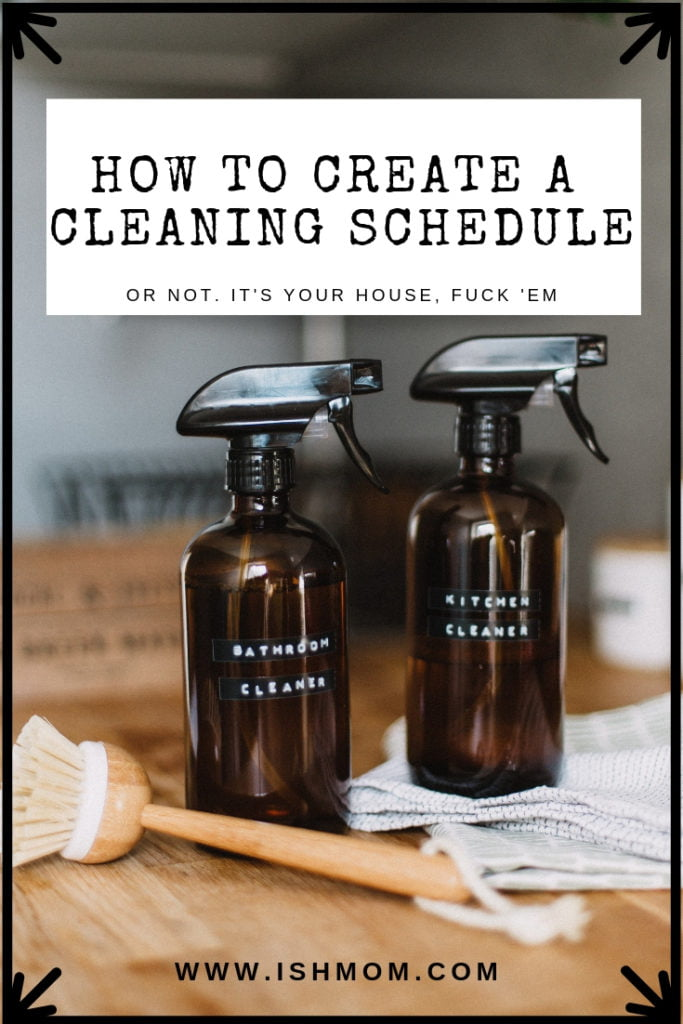 bottles of homemade cleaner and brush on wooden counter