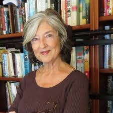 barbara kingsolver in front of bookcase