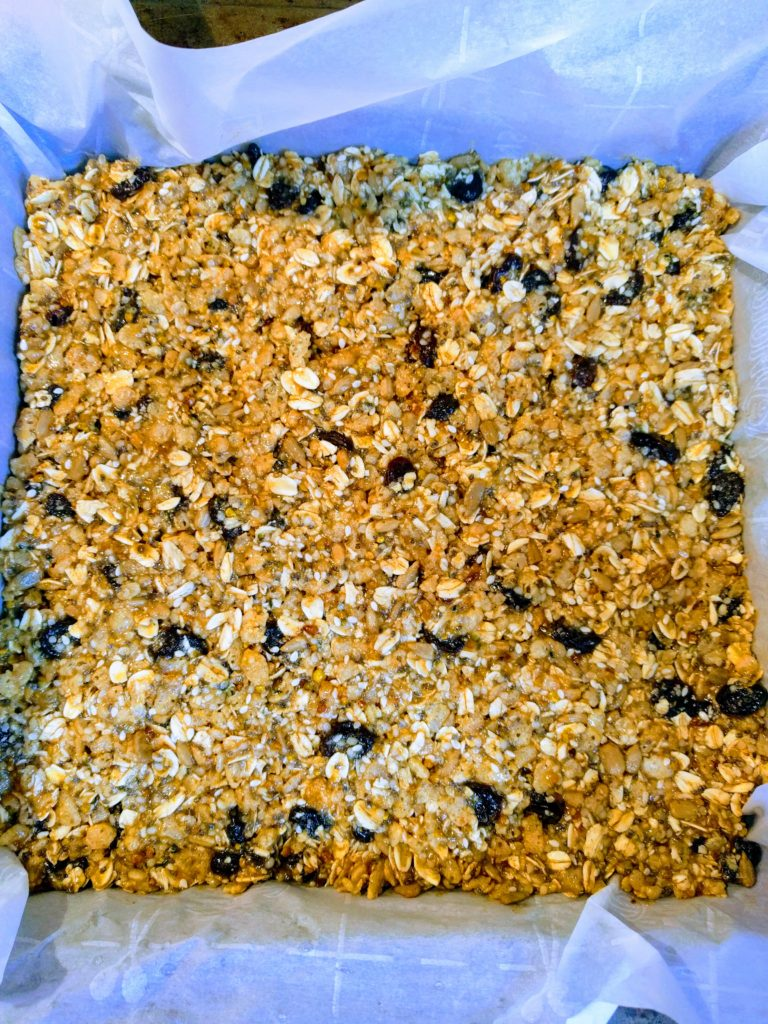 homemade granola bars uncut in pan