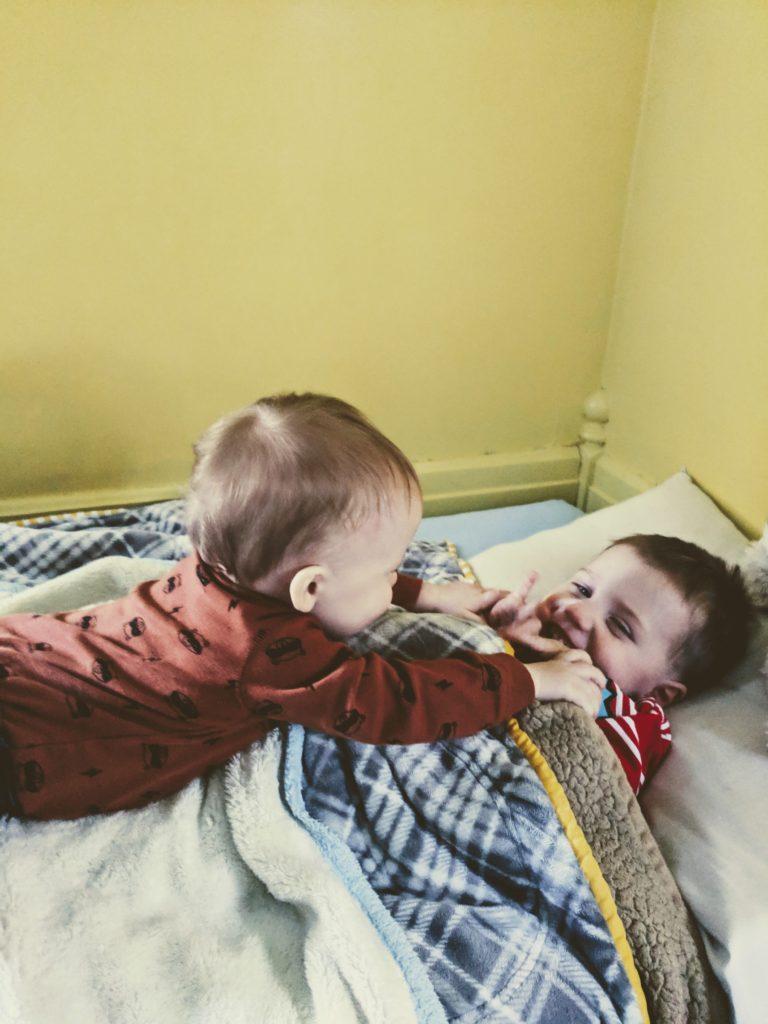 year old baby tickling toddler