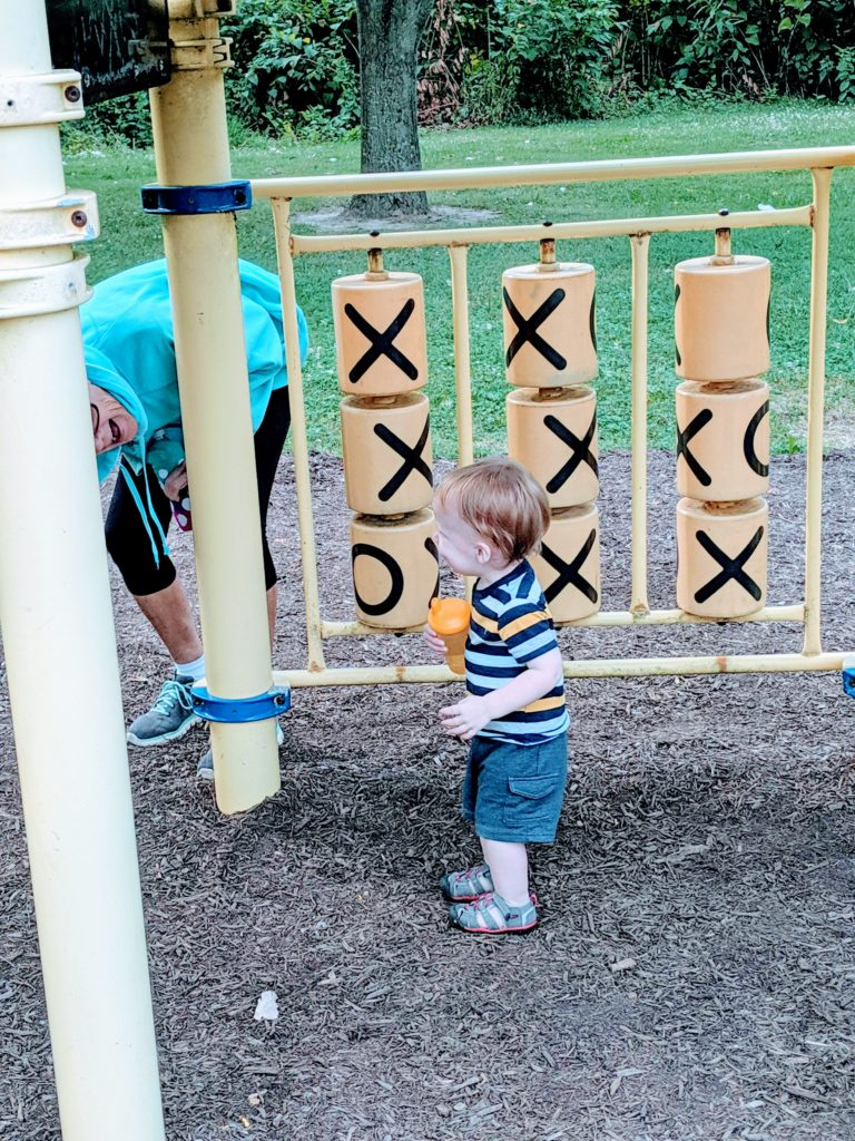 Little A working on gross motor skills at the playground with grandma