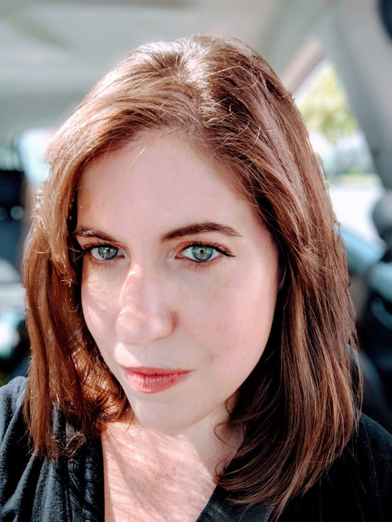 megan wearing makeup in the car