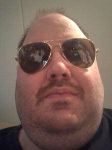 Christopher Durham wearing aviator glasses