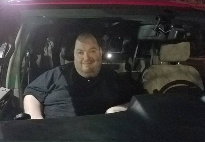 Christopher Durham in passenger seat of mobility van