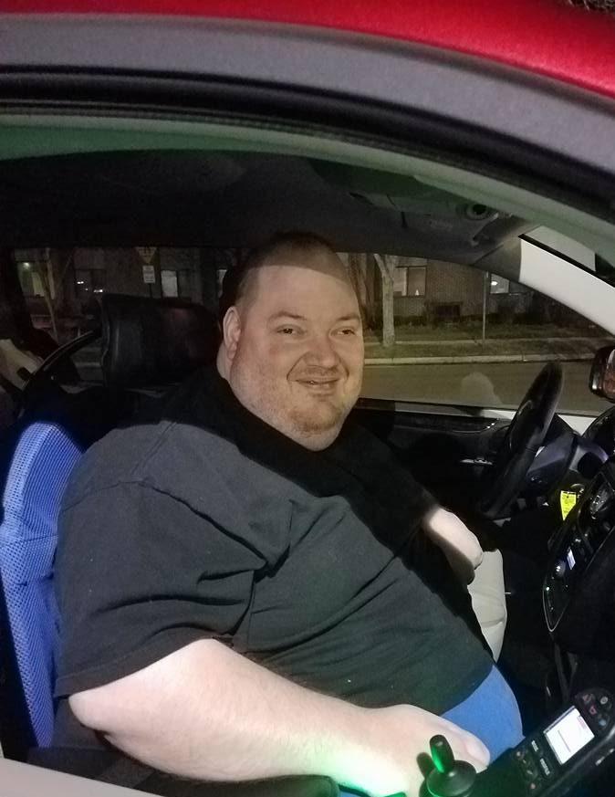 Christopher Durham smiling in his van