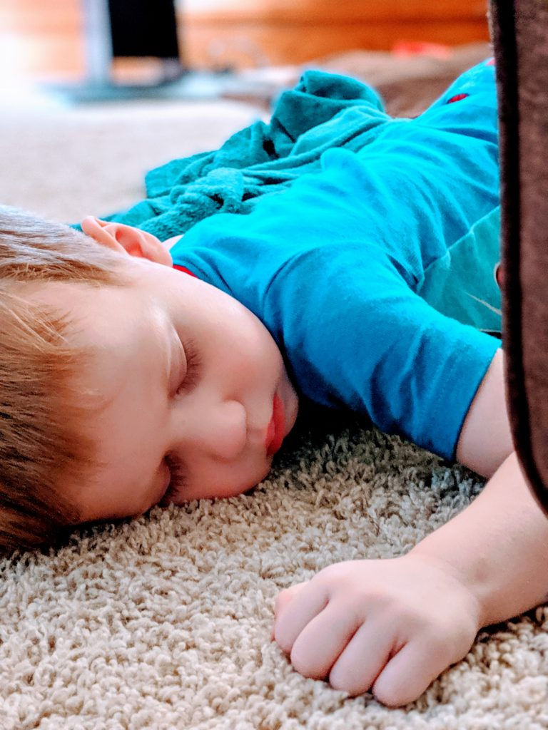 autistic toddler sleeping on the floor