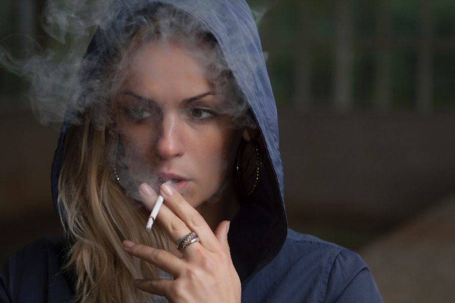 woman smoking due to emotional labor