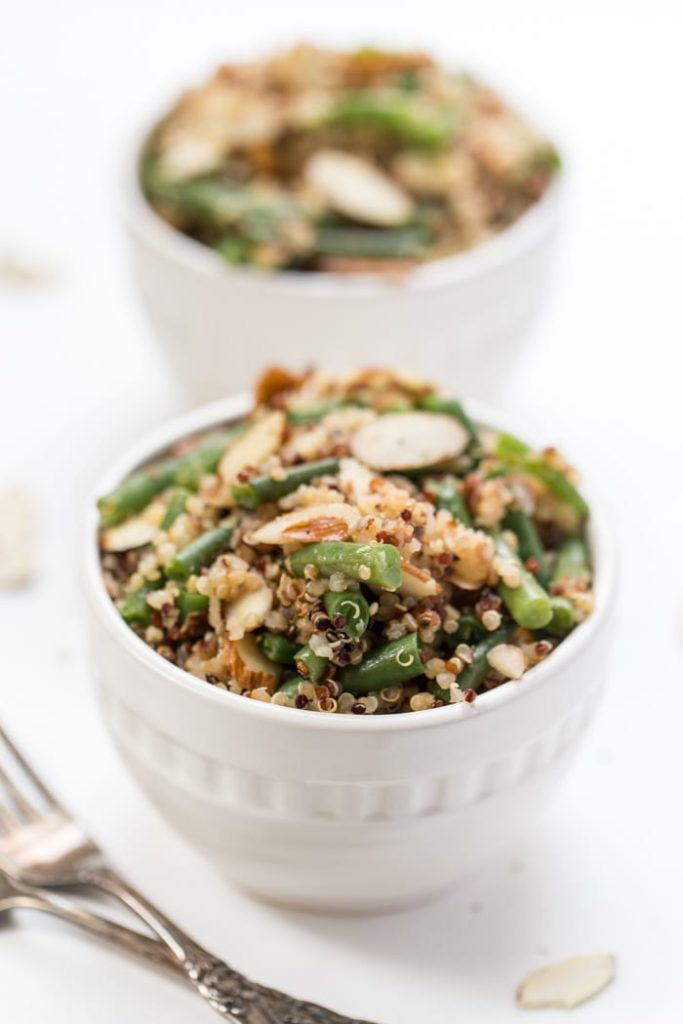 two bowls of green bean and almond quinoa salad