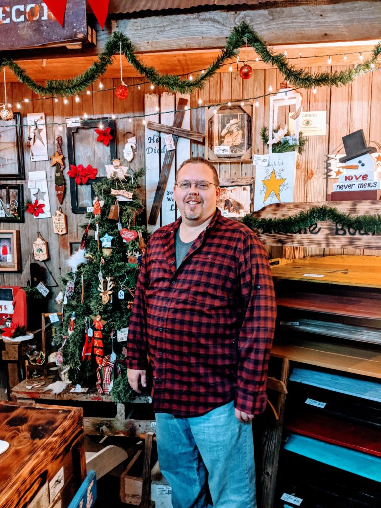 Chris Griffy primitive woodworking artist and co-owner of Beyond Country Decor