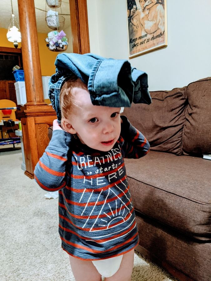 little a with pants on his head