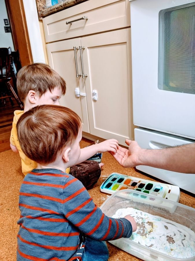 Big and Little A doing science activities during home preschool