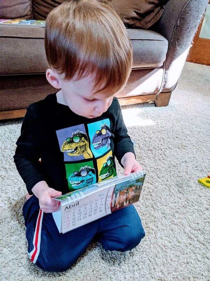Little A doing calendar work during home preschool