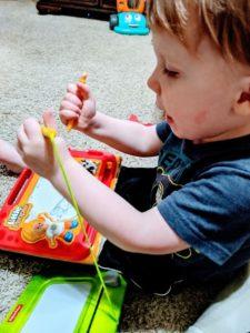 Little A doing home preschool schedule