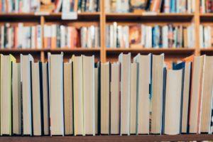 row of books on a book shelf