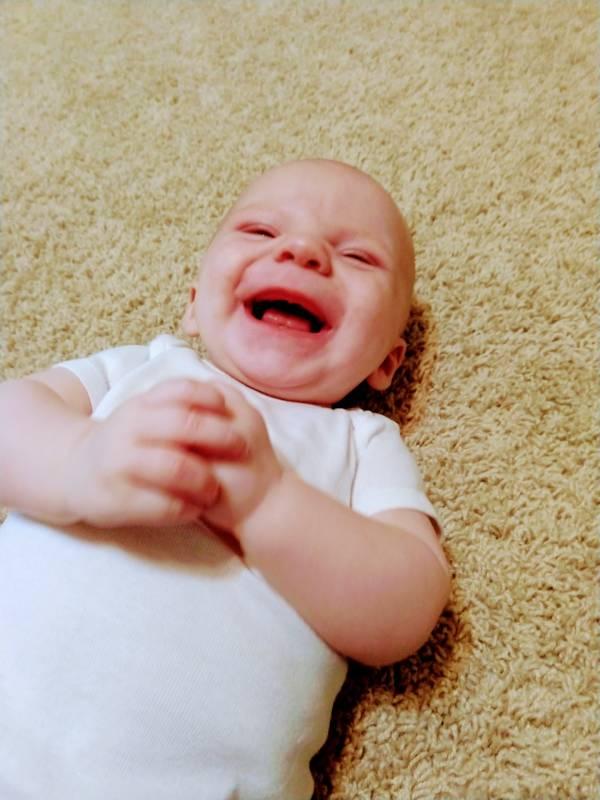 new baby smiles
