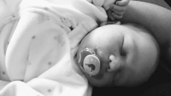 black and white photo of newborn baby