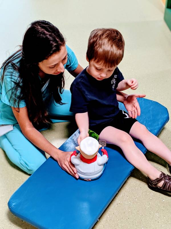 child with occupational therapist