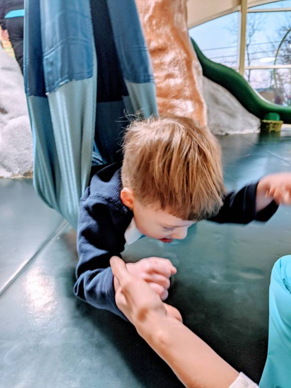 autistic toddler building gross motor skills in occupational therapy