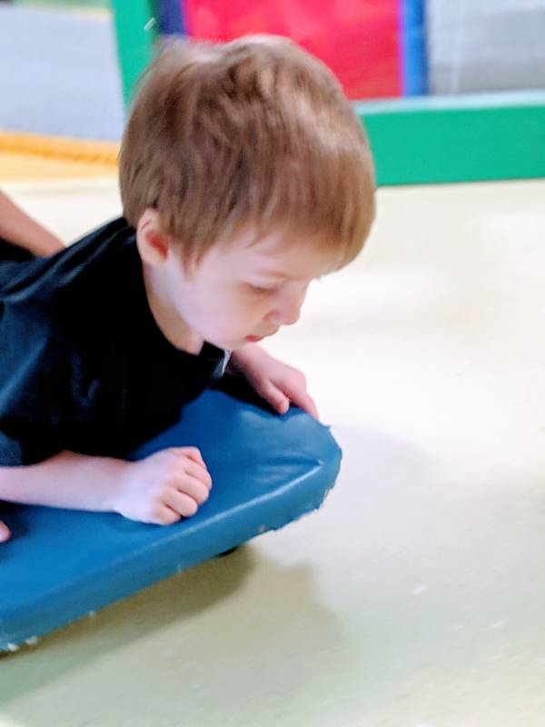 autism using scooter at occupational therapy