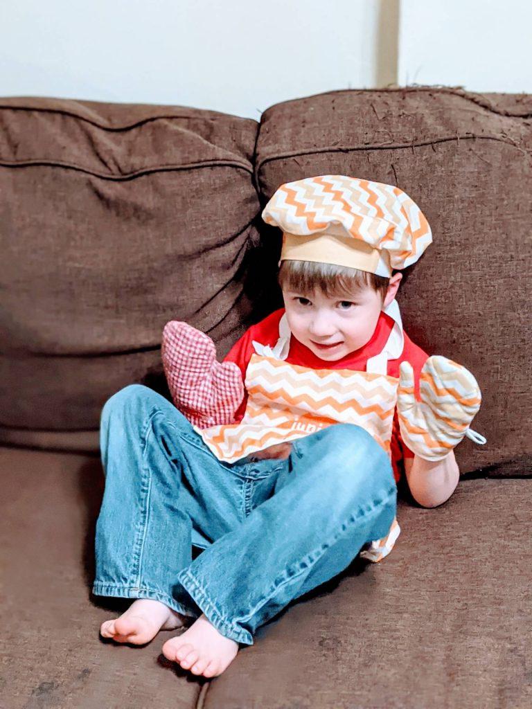 autistic boy in chef costume