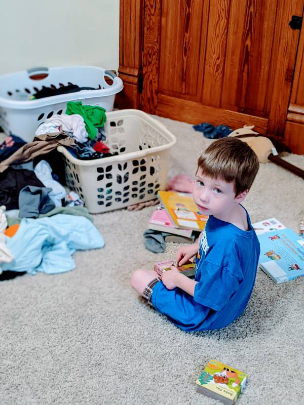 Autistic boy helping with laundry