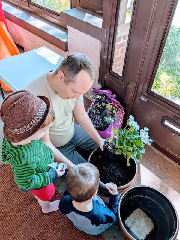 children doing outdoor chores