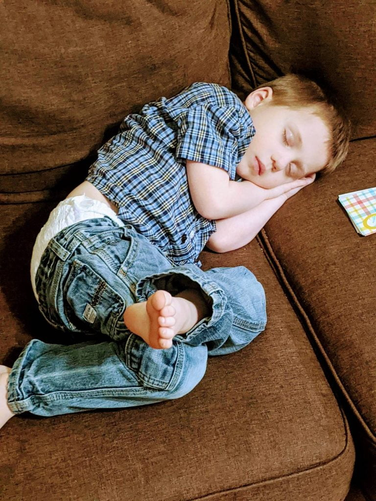 tired kid falling asleep after helping with chores